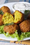 Falafel with lettuce and tzatziki sauce closeup vertical Royalty Free Stock Photo