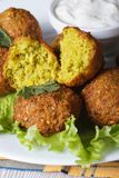 Falafel with lettuce and tzatziki sauce vertical Royalty Free Stock Photo