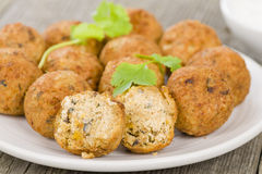 Falafel. Middle Eastern chickpea and fava beans fried balls served with tzatziki. Traditional spicy snack Stock Photos