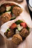 Falafel, fried chickpea balls. Falafel, middle eastern fried chickpea balls, popular fast food meal Royalty Free Stock Photo