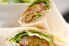Falafel pita bread roll wrap sandwich. Traditional arab middle east food Stock Photo