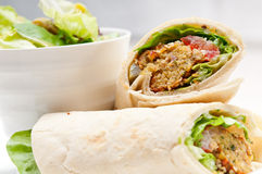 Falafel pita bread roll wrap sandwich. Traditional arab middle east food Royalty Free Stock Photography