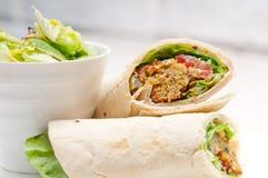 Falafel pita bread roll wrap sandwich. Traditional arab middle east food Stock Photos