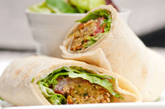 Falafel pita bread roll wrap sandwich. Traditional arab middle east food Royalty Free Stock Images