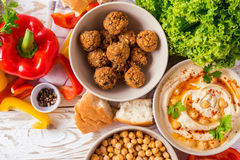 Falafel, pita, hummus and chickpea  with vegetables. Top view Stock Images