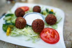 Falafel on a plate. Closeup of falafel on a plate with selective focus Royalty Free Stock Image