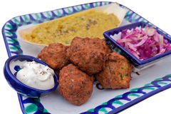 Falafel Plate. Dhal, Red Cabbage Salad, Falafel and White Dip on a Colourful Plate Stock Photos