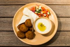 Falafel with salad and sauce stock photos