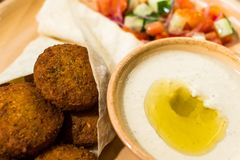 Falafel with salad and sauce stock images