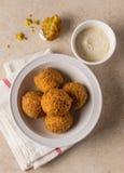 Falafel with sauce. Stock Photos