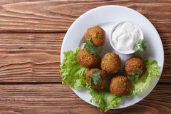 Falafel with sauce tzatziki close-up view from above Royalty Free Stock Image
