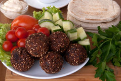 Falafel served with vegetables Royalty Free Stock Photography