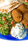 Falafel and tabbouleh. Falafel served with fresh tabbouleh and pita on blue plate Stock Image
