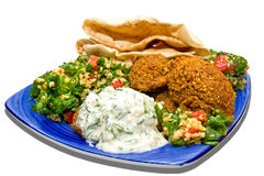 Falafel and tabbouleh. Falafel served with fresh tabbouleh and pita on blue plate. Isolated on white Royalty Free Stock Photography