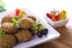 Falafel. Is a traditional Middle Eastern deep-fried ball or patty made from ground chickpeas, fava beans Stock Image