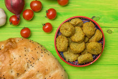 Falafel, turkish pide bread and vegetables Royalty Free Stock Photography