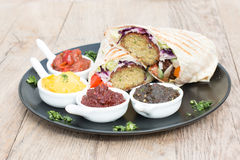 Falafel warp. Typical italian anti pasti on wood table royalty free stock images