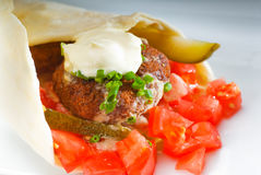 Falafel wrap. Fresh traditional falafel wrap on pita bread with fresh chopped tomatoes Stock Images