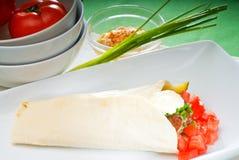 Falafel wrap. Fresh traditional falafel wrap on pita bread with fresh chopped tomatoes Stock Photo