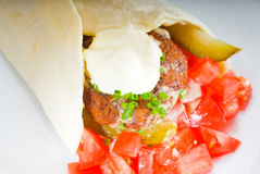 Falafel wrap. Fresh traditional falafel wrap on pita bread with fresh chopped tomatoes Stock Image