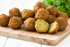 Falafels and hummus on a white wood stock photo