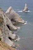 Falaises et cavernes de mer Photographie stock