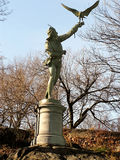Falconer of Central Park. A statue of a human holding a falcon in Central Park, New York Royalty Free Stock Photos