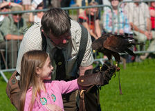 Falconer and girl at Westmorland Show Stock Photos