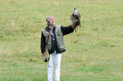Falconer and raptor Royalty Free Stock Photos