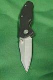 Falcowanie nóż na zielonym tle fotografia royalty free
