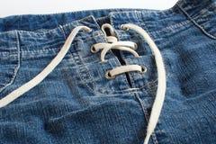 Falda de los vaqueros con cierre del cordón para arriba Imagen de archivo libre de regalías