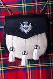 Falda escocesa y escarcela de los montañeses de Escocia imágenes de archivo libres de regalías