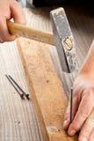 Falegnameria del chiodo e del martello Fotografia Stock