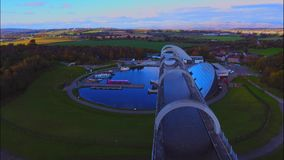 The Falkirk Wheel. Near Falkirk in Scotland. A unique boat lift that connects the Forth and Clyde canal with the Union canal stock footage