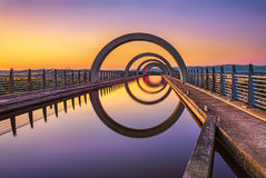 Falkirk Wheel at sunset, Scotland, United Kingdom. Falkirk Wheel at sunset. Falkirk Wheel is a rotating boat lift in Scotland and connects the Forth and Clyde Stock Images