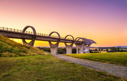Falkirk Wheel at sunset, Scotland, United Kingdom. Falkirk Wheel at sunset. Falkirk Wheel is a rotating boat lift in Scotland and connects the Forth and Clyde stock image