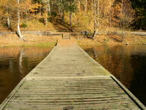 Fall. Wooden jetty in the fall Royalty Free Stock Images