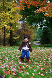 Fall. A toddler enjoying the fall in the forest Royalty Free Stock Photography