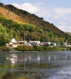 Fall afternoon along the Mississippi River in Wisconsin. Small town along the Mississippi River in Wisconsin showing the beginning of fall colors in the bluffs stock photo