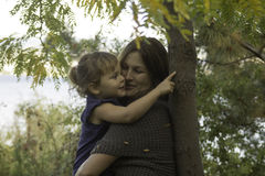 Fall is in the air. This mom and daughter are enjoying soem together time at the park Stock Photography