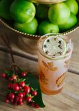 Fall alcoholic beverage in a tall pint glass. Garnished with limes on rustic background Stock Image