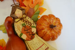 Fall Angel holding pumpkin with leaves background Stock Photo