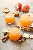 Fall apple cider with warm spices. Cinnamon and nutmeg Stock Photography