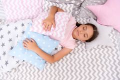 Fall asleep as fast as possible. Fall asleep faster and sleep better. Healthy sleep. Sweet dreams. Girl child lay bed. Pillow and blanket bedroom top view royalty free stock photography