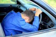 Fall asleep in a car. Young man fall asleep in a car stock photos