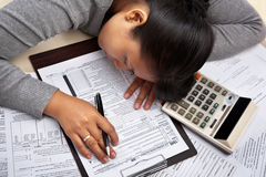 Fall asleep before filling tax form Royalty Free Stock Photography