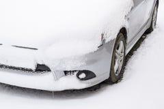 Fall asleep wet snow car. Snowfall of wet snow. Snow lying on the car Stock Photos