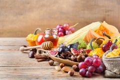 Fall autumn harvest background with pumpkin apple chestnut corn Royalty Free Stock Image
