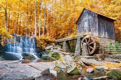 Fall or Autumn image of historic mill and waterfall Stock Photos
