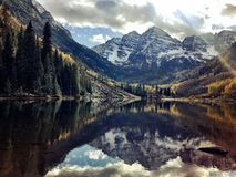 Maroon Bells reflection in lake in afternoon during the Fall royalty free stock image